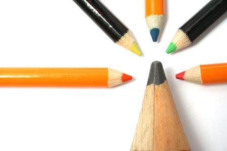 The big pencil and five small color pencils on a horizontal 5 photo
