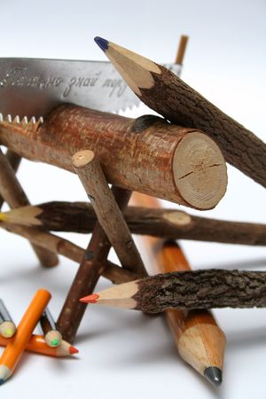 errands: Three color pencils made of branches of a tree and three small under a saw and a log detailed Stock Photo