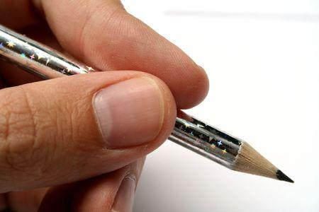 the plotting: Celebratory brilliant pencil for plotting in mans hands 1
