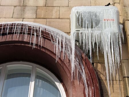 Icicles on the conditioner in frosty day in Volgograd