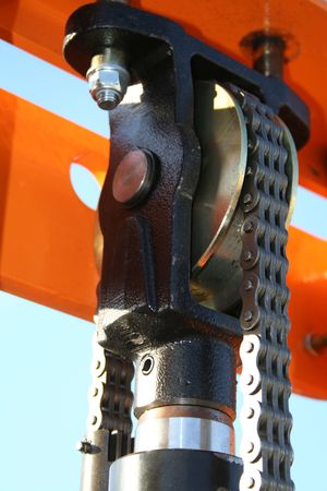 The hydraulic elevating mechanism with a driving chain, (look similar images in my portfolio)