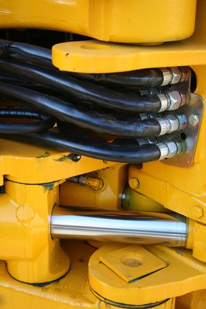 hydraulic hoses: Hydraulic elements of the heavy building bulldozer of yellow color, (look similar images in my portfolio) Stock Photo