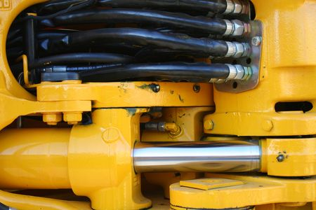 hydraulic hoses: Hydraulic elements of the heavy building bulldozer of yellow color horizontally, (look similar images in my portfolio) Stock Photo
