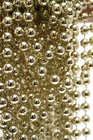 Celebratory brilliant beads of golden color vertically 1 photo