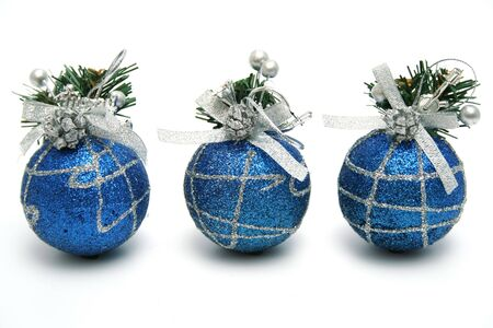 Three christmas spheres of dark blue color with a pattern horizontally