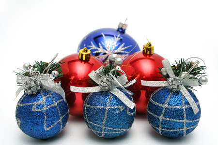 Set of celebratory christmas-tree decorations of dark blue and red color on a white background  photo