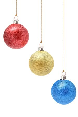 Christmas christmas-tree decorations of red, yellow and dark blue color  Foto de archivo