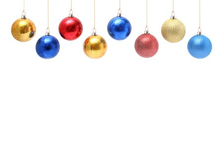 Christmas celebratory ornaments in the form of multi-coloured glass spheres above