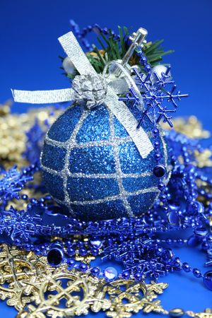 Christmas sphere of dark blue color with a pattern and a celebratory beads