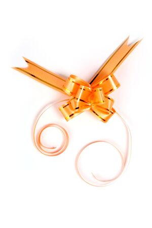Gift bow of yellow color on a white background  Stock Photo