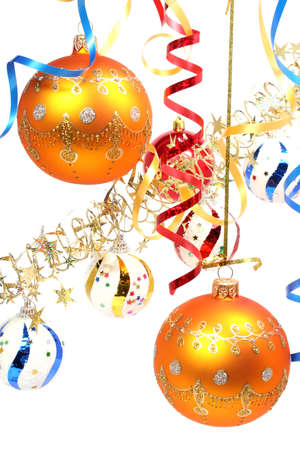 Two yellow New Years spheres on a background of a celebratory tinsel  Stock Photo
