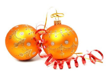 Two New Years spheres of orange color and red celebratory tinsel  Stock Photo
