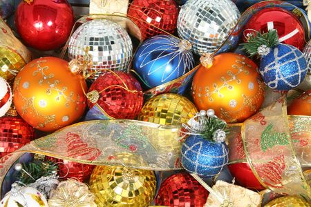 Christmas ornaments of different color and gift ribbons