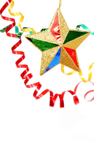 Multi-coloured celebratory tinsel and christmas star on a white background  Stock Photo