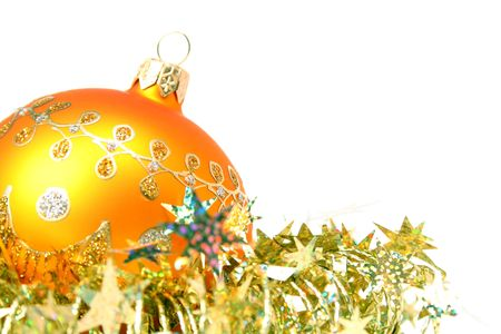 Christmas sphere of yellow color and celebratory tinsel on a white background  Stock Photo