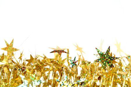 Celebratory tinsel of golden color with christmas stars Foto de archivo