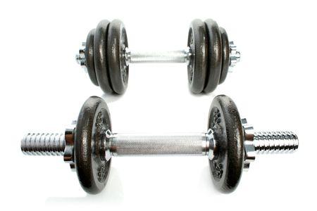 kilograms: Iron dumbbells isolated on white 4 Stock Photo
