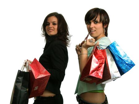 The happy girls with purchases, on a white background Stock Photo - 1809103