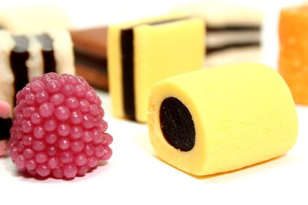 Fruit sweets in the form of various color rolls 2, isolated on white, (look similar images in my portfolio) Stock Photo - 1868456