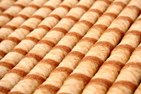 Striped wafer tubules with a chocolate cream, (look similar images in my portfolio) photo