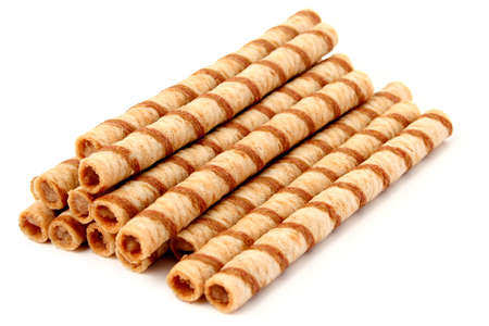 Heap of striped wafer tubules with the chocolate cream, isolated, (look similar images in my portfolio) photo