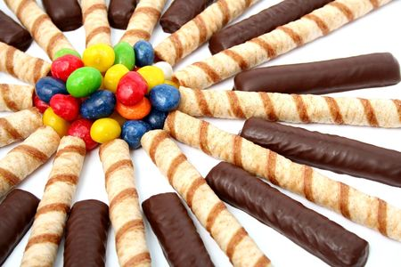 sweetness: Chocolate sticks with a cream and the multi-coloured sweets isolated, (look similar images in my portfolio)