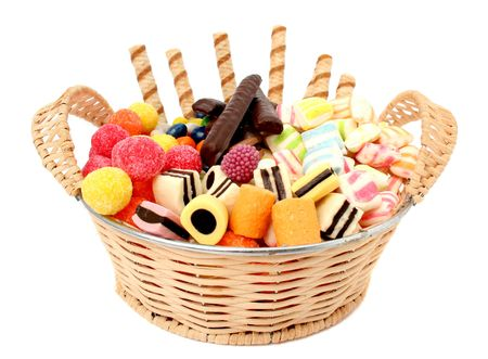 Basket with various sweets and the cookies, isolated, (look similar images in my portfolio)