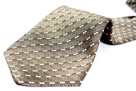 The bottom part of a tie of the businessman, isolated on white, (look similar images in my portfolio) photo
