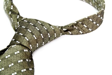 Tie with a simple pattern - a personal accessory of the businessman, isolated on white, (look similar images in my portfolio) photo