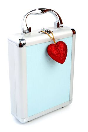 Briefcase and heart isolated 2 photo