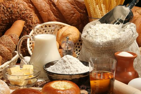 Bread, flour, milk, oil, macaroni, background Stock Photo