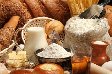 Bread, flour, milk, oil, macaroni, background Archivio Fotografico
