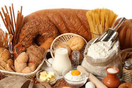 Surtido de panes y los ingredientes, los antecedentes  Foto de archivo