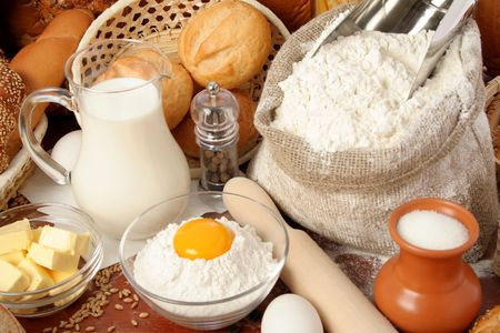 Bread, flour, milk, butter, eggs, background