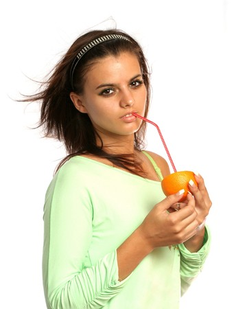 beautiful girl with sliced orange on white Stock Photo - 4510530