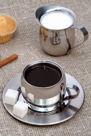Cup of black coffee with muffin, milk and cinnamon, coffee series