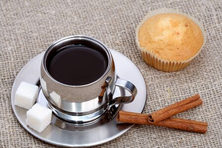 Cup of black coffee with muffin and cinnamon, coffee series