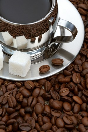 Cup of coffee with lump sugar and beans, coffee series