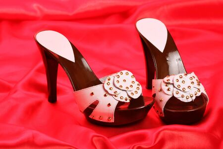 Woman shoes on red satin