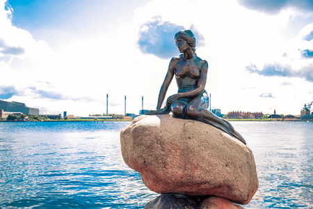 The Little Mermaid statue by the waterside at the Langelinie promenade in Copenhagen, Denmark Stock Photo