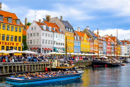 townhouses: Nyhavn - Copenhagen, Denmark  - 17th century waterfront, canal and entertainment district in Copenhagen, Denmark. Editorial