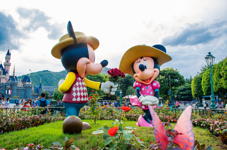 HONG KONG DISNEYLAND - MAY 2015: Mickey and minnie in love at the park in front of the castle Editorial