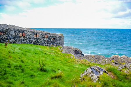Beautiful coast of the Isle of Man from Peel Hill with great wall of Peel Castle in Peel, Isle of Man