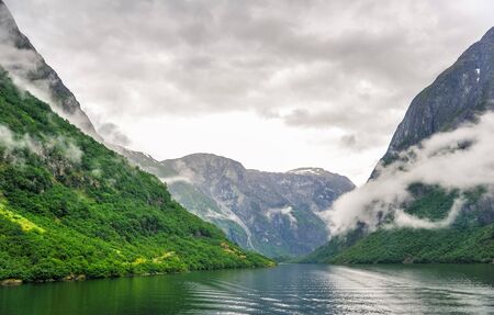 Beautiful landscape and scenery view of fjord in a cloudy day, Norway Stock Photo