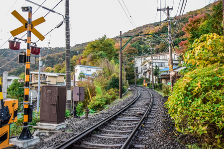 Urban train track (railway) cross the city of Hakone in Japan Stock Photo