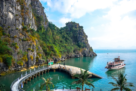 unesco world heritage site: Pier surrounded by limestone karst of Ha Long Bay in Quang Ninh Province, northeast Vietnam Stock Photo