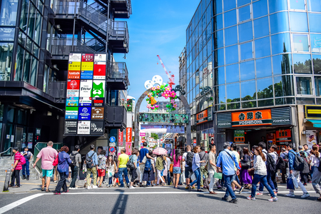 harajuku: TOKYO, JAPAN: People are shopping at Takeshita street, a famous shopping street lined with fashion boutiques, cafes and restaurants in Harajuku in Tokyo, Japan Editorial