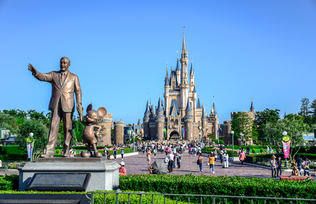 dream land: CHIBA, JAPAN: Walt Disney statue with view of Cinderella Castle in the background, Tokyo Disneyland Editorial
