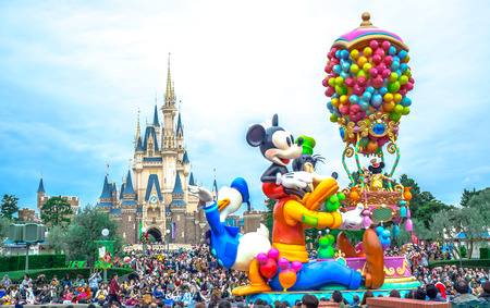 CHIBA, JAPAN: Crowds seeing daytime parade in front of Cinderella Castle at Tokyo Disneyland