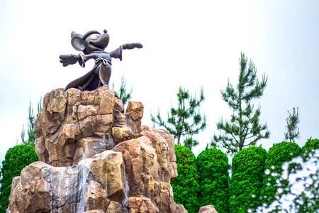 hotel building: CHIBA, JAPAN: Mickey Mouses Fantasia statue in front of Tokyo Disneyland Hotel, Urayasu, Chiba, Japan